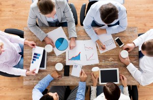 business, people, statistics and team work concept - close up of